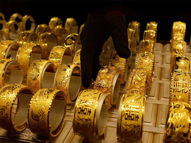 Gold Rate Rises Hover Near Record High Level The Economic Times