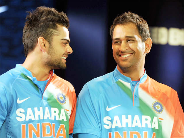 f0d9cbc8d Indian captain Virat Kohli shares a light moment with Mahendra Singh Dhoni  at the unveiling of a T20 kit for Team India. And while there have been  rumours ...