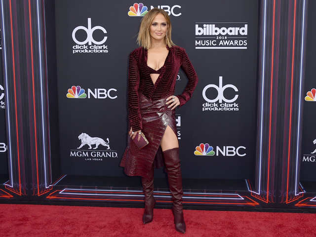 738f2c4a996e A vision in burgundy, the singer wore thigh-high boots, asymmetrical animal  skin skirt, and a velvet bralette with a full-sleeved jacket.