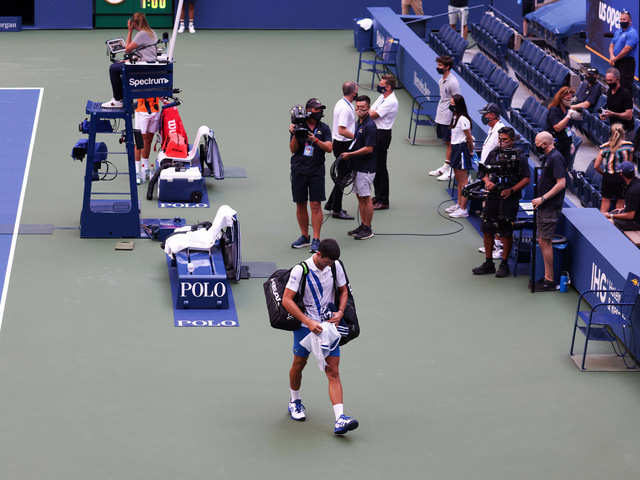 Novak Djokovic World No 1 Novak Djokovic Disqualified From Us Open After Hitting Official With Ball The Economic Times