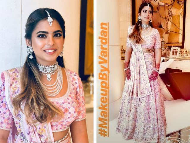 03293aa148 Akash s twin sister Isha Ambani looked gorgeous in a bespoke creation by  Abu Jani Sandeep Khosla. She completed her look with exquisite