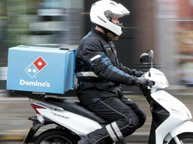 Domino's and ITC Foods partner to deliver groceries - The Economic ...
